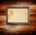 Old gilded wooden frame on grange wall Royalty Free Stock Images