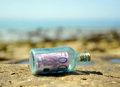 Old glass bottle with 500 euro banknote inside, power of money Royalty Free Stock Photo