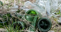 Old glass bottles, pollution Royalty Free Stock Photo