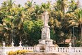 Old Goa, India. Cathedral Of St. Paul And Statue Of Jesus In Sunny Day Royalty Free Stock Photo