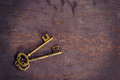 Old gold key vintage on wood background with space Royalty Free Stock Photo