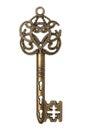 Old gold skeleton key isolated on white background. Royalty Free Stock Photo