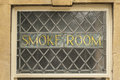 Old gold smoke room sign in pub window Royalty Free Stock Photos