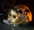 Old gold venetian masks on a glass table Stock Photo