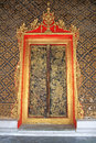 Old golden carved doors thai temple Royalty Free Stock Images