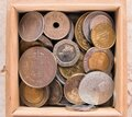 Pile of gold and silber coins in wood box on the natural background Royalty Free Stock Photo