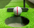 Old golf balls and putter on artificial grass close up for practice Stock Photo