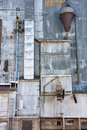 Old grain elevator industrial background a metal exterior of with pipes ducts ladders and chutes Royalty Free Stock Photography