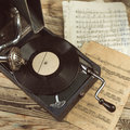 Old gramophone enjoying the music listening vintage vinyl records on an top view toned tinted filtered square photo instagram Stock Photography