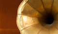 Old gramophone horn detail on wooden background Royalty Free Stock Photo