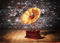 Old gramophone over grunge interior Stock Photos