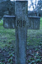Old grave RIP Rest in peace crucifix on a cemetery Royalty Free Stock Photo