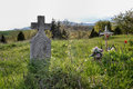 Old grave on traditional European cemetery in Slovakia. Aged cross tomb stone on grave yard in spring Royalty Free Stock Photo