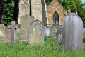 Old graves in cemetery with church background england Stock Photography