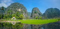 An old graveyard in ninh binh vietnam reflecting a lake Royalty Free Stock Images