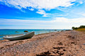 Old greek fisherman boat on a baltic sea beach Stock Photography