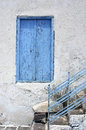 Old greek window and stairs Stock Image