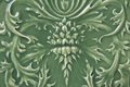 Old green ceramic tile with floral pattern Royalty Free Stock Photography