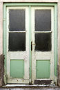 Old green double doors with windows Stock Images