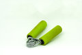 Old green hand grip equipment for hand massage and exercise. Royalty Free Stock Photo