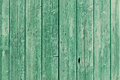 Old green painted weathered wooden planks background texture of forming an exterior cladding on a wall of a building or a fence Royalty Free Stock Photos