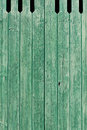 Old green painted weathered wooden planks background texture of forming an exterior cladding on a wall of a building or a fence Stock Photo
