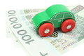 Old green toy car with money on white background Royalty Free Stock Photo