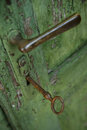 Old green weathered door handle and lock. Royalty Free Stock Photo
