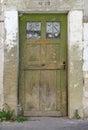 Old, green, weathered wooden door