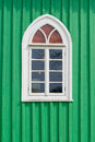 Old green wooden wall with window white Stock Photos
