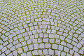 Old grey pavement of cobble stones in a circle pattern in an medieval european town Stock Photos
