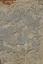 Old grey unpainted plaster wall with cracks Royalty Free Stock Photo
