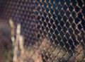 Old grid steel iron metallic rusty fence. Industrial Royalty Free Stock Photo