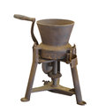 Old grinding mill isolated rusty and worn metal hand turned Royalty Free Stock Images