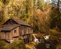 Old grist mill an still in operation in woodland washington processes corn and wheat on stone millstones Royalty Free Stock Photos