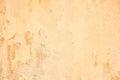 Old grunge cracked orange concrete wall Royalty Free Stock Photo