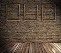 Old grunge interior with blank frames Royalty Free Stock Photo