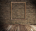 Old grunge interior with blank picture frame Royalty Free Stock Photo