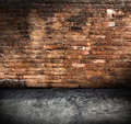 Old grunge interior with brick wall Stock Images