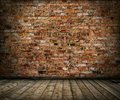Old grunge interior with brick wall and floor Royalty Free Stock Photo