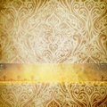 Old grunge paper texture and vintage floral ornament. Royalty Free Stock Photo