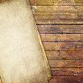 Old grunge paper on wooden background Stock Photo