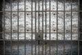 Old Grunge Prison seen through Jail Bars Royalty Free Stock Photo