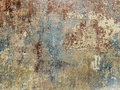 Old grunge wall of an old house with remainings of color Stock Photos