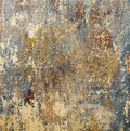 Old grunge wall of an old house with remainings of color Stock Images