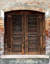 Old grunge window wooden with wall in italy Stock Images