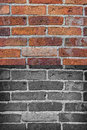 Old grungy brickwall texture background in two different variations natural with red bricks and monochromatic black and white Royalty Free Stock Photo