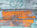 Old grungy painted wood background with weathered boards blue and orange with a grain texture full frame Stock Photo