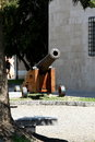 Old gun fortress cannon with a wooden carriage next to the building in palma de mallorca mallorca spain Stock Image