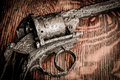 Old gun on wooden table Royalty Free Stock Photo